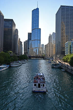 Chicago, Illinois - August 8, 2019 - Trump Tower and Chicago River on a clear summer morning.