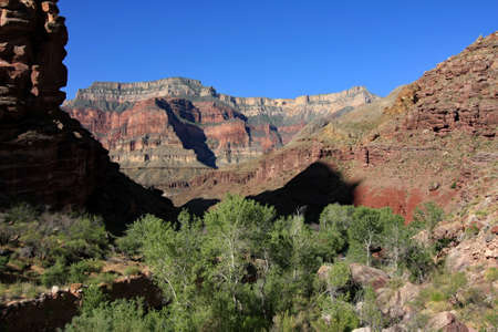 View of canyon walls from Upper Tapeats Campground in Grand Canyon National Park, Arizona on clear summer morning.