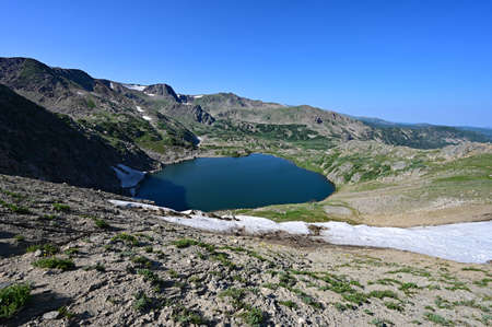 King Lake in Indian Peaks Wilderness of Arapaho National Forest, Colorado on sunny clear summer afternoon.