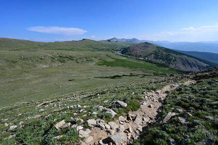 Alpine tundra above tree line on High Lonesome Trail in Indian Peaks Wilderness in Arapaho National Forest, Colorado on clear sunny summer afternoon. Stock Photo
