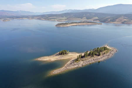 Aerial view of Deer Island on Lake Granby, Colorado on calm sunny summer morning.