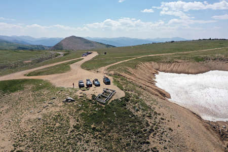 Aerial view of parking area at King Lake trailhead in Indian Peaks Wilderness in Arapaho National Forest, Colorado on sunny summer afternoon. Stock Photo
