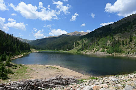 Upper Urad Reservoir in Arapaho National Forest, Colorado under sunny summer cloudscape. Stock Photo