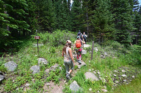 Hikers on Hassell Lake Trail in Arapaho National Forest, Colorado on sunny summer afternoon. Stock Photo