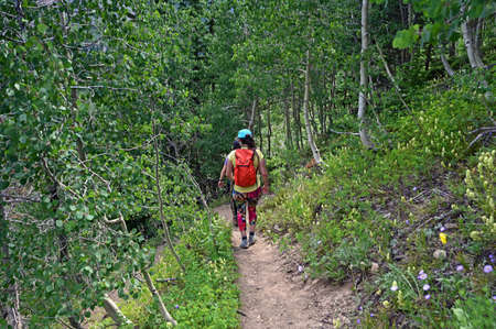 Two young women on Hassell Lake Trail in Arapaho National Forest, Colorado on sunny summer afternoon.