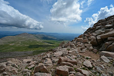 View from summit parking area of Mount Evans, Colorado under dramatic summer cloudscape. Stock Photo