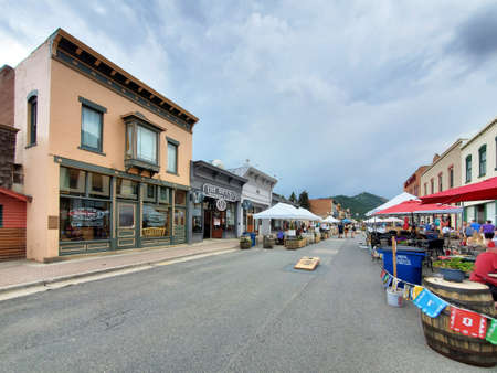 Idaho Springs, Colorado - July 30, 2021 - Street scene of main commercial area on sunny summer afternoon.