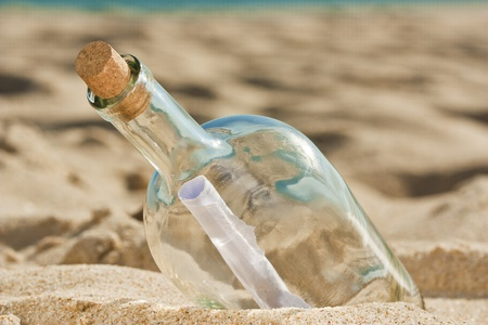 Lost message inside a bottle ashored at the beach and is waiting for someone to find it Stock Photo