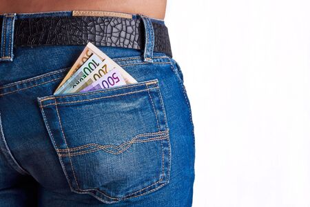 cash back: Girls Shows her money inside her Jeans Back Pocket Stock Photo