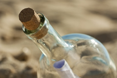 Lost message inside a bottle ashored at the beach and is waiting for someone to find it photo