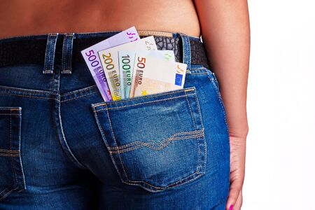 Girls Shows her money inside her Jeans Back Pocket Stock Photo