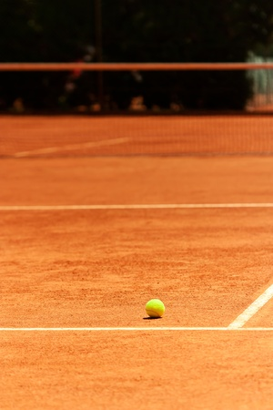 tennis net: Tennis Ball stands on a Court during a game (excellent background for Tennis Events Media)