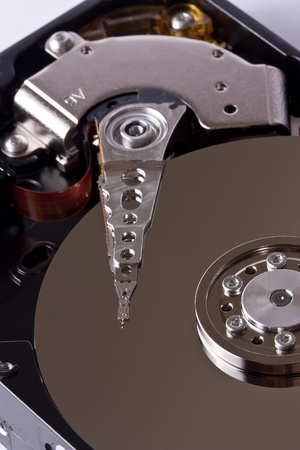 Close-up of an open Hard Disk Drive photo