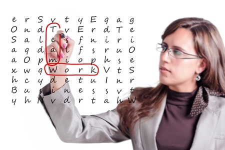 combined effort: Woman finds on a whiteboard crosswords a few key points of Teamwork Stock Photo