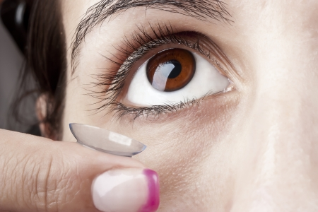 Woman applying a Contact Lens on her eye Stock Photo - 10472196