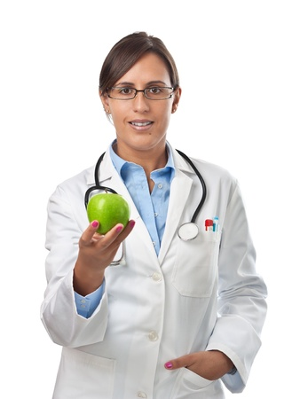Doctor giving an apple to a patient as a perfect healthy eating example photo