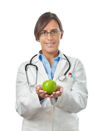 Doctor Showing an apple with both hands as a perfect healthy eating example photo