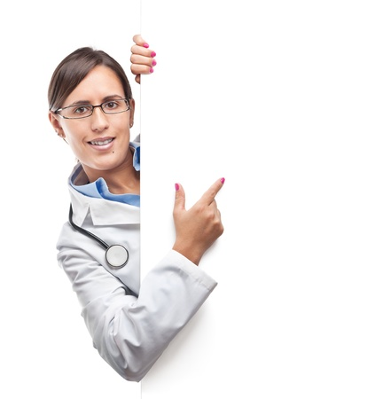 Doctor is pointing something in a blank cardboard sign Stock Photo