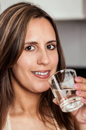 Smiling Woman about to drink a glass of water Stock Photo - 14741821