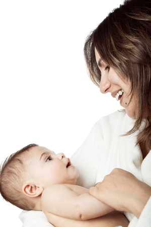 Mother holds baby in her arms looking at eachother eyes in tenderness Stock Photo