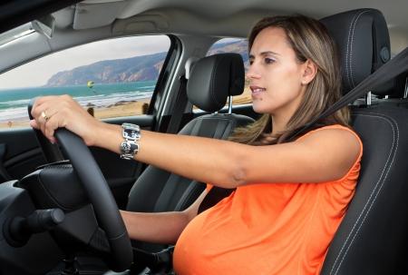 seats: Pregnant Woman Driving a Car Through the Beach Road