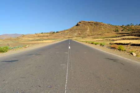 Straight ethiopian road, somewhere on the way to Lalibela among the teff fields of the central ethiopian plateau