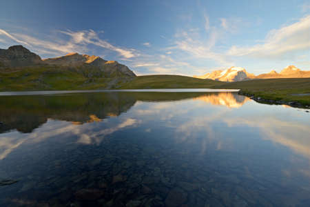 Last light over the highest mountain peak in Piedmont  Italy , Gran Paradiso  4061 m , reflecting on the Rosset Lake  2700 m  photo