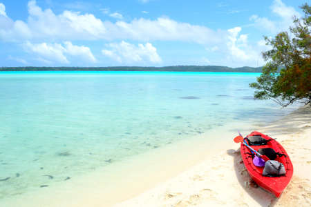Exploring the Aitutaki gorgeous lagoon  Cook Islands  by canoeing is the best way to reach little desert islands Stock Photo