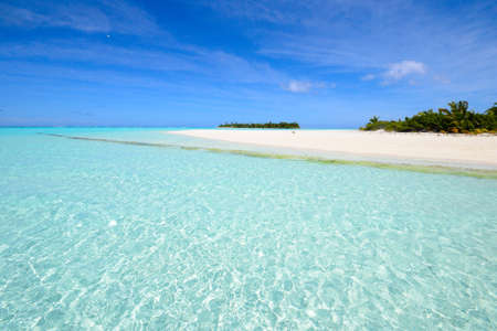 motu: Superb transparent water near the scenic Honeymoon Island  Motu Maina , Aitutaki atoll, Cook Islands