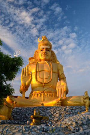 soul searching: Golden statue of Lord Shiva with his lingam at Koneswaram temple in Trincomalee, Sri Lanka, an important hindu shrine Stock Photo