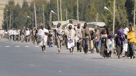 Korem, Ethiopia - January 26, 2012: people going to the market in the main street of Korem, a small village on the highway Mekele - Lalibela, central Ethiopia. Stock Photo - 16348419