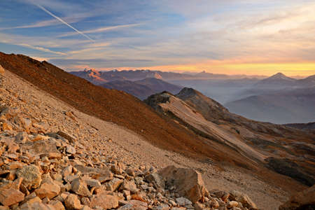 bardonecchia: A stunning sunset high in the italian Alps on an extreme rocky landscape, near Bardonecchia, Torino Province, North-West Italy