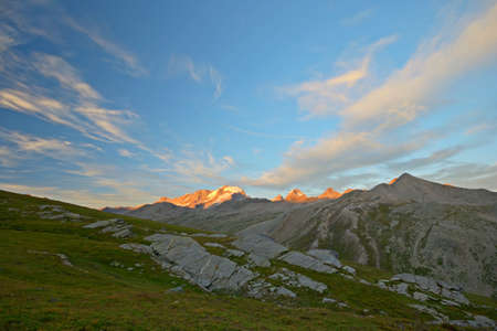 Golden light over the highest mountain peak in Piedmont  Italy , Gran Paradiso  4061 m , at the border with Aosta Valley and Vanoise National Park  France  Stock Photo