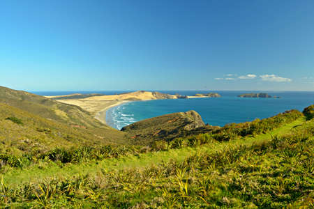 reinga: Stunning view of the Ninety Mile Beach northest point at Cape Reinga in a bright winter day  Stock Photo