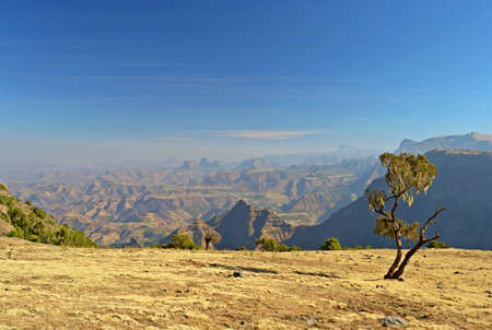 Wide angle view from the Simien Mountains National Park overlooking the Ethiopian plateau, under hard light condition  photo