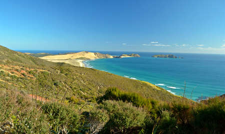 Tasman Sea at Cape Reinga, the northernmost point in New Zealand photo
