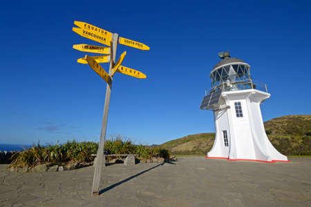 Cape Reinga lighthouse and signpost, the northernmost point in New Zealand Stock Photo - 16673369
