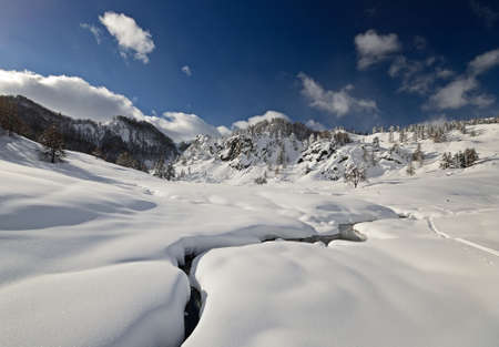Winter landscape and ski touring in the italian Alps after heavy snowfalls photo