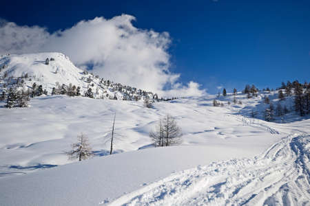 winter landscape: Winter landscape and ski touring in the italian Alps after heavy snowfalls Stock Photo