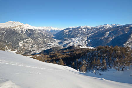 Winter panoramic landscape and snow covered slopes in an alpine Valley of Torino Province viewed from the top Stock Photo - 16778604