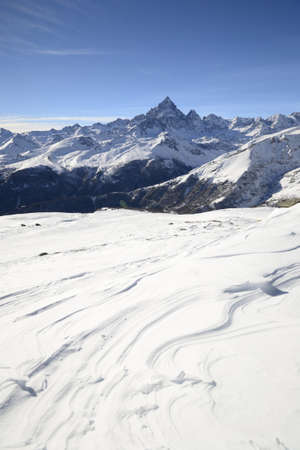 Winter mountainscape and superb frontal view on the majestic M  Viso  3841 m , Po Valley, Piedmont, with windswept snowdrifts in the foreground Stock Photo - 16938181