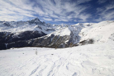 cuneo province: Winter mountainscape and superb frontal view on the majestic M  Viso  3841 m , Po Valley, Piedmont, with wind shaped snow in the foreground  Stock Photo