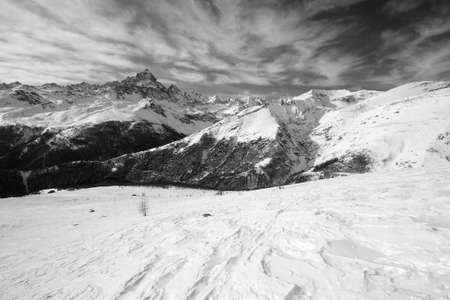 Black and white version of the majestic M  Viso  3841 m , Po Valley, Piedmont, in winter time with wind shaped snow in the foreground Stock Photo - 17076029