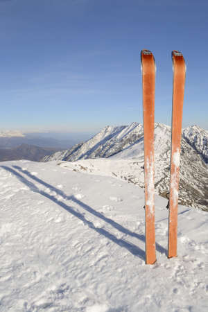 Pair of back country ski on the top with scenic view of the italian western Alps in winter  photo