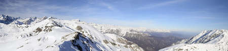 Superb panoramic view of the majestic alpine arc from Gran Paradiso  over 4000 m  to Monte Rosa  over 4000 m  in winter time  Stock Photo - 17167037