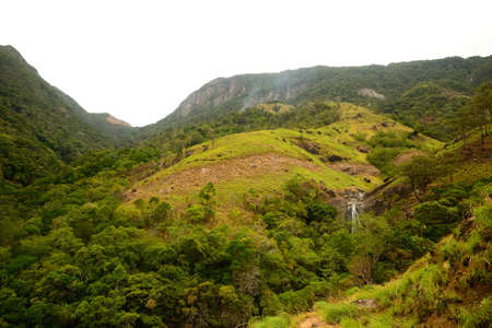 Sri Lankan landscape with waterfall near Horton Plain and Worlds End photo