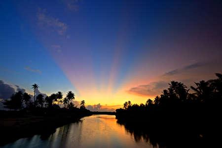 Wonderful sunset on Tangalla backwaters, Sri Lanka, high contrast effect on light rays