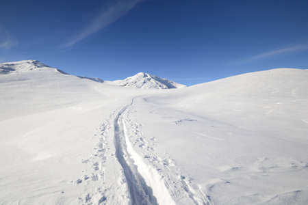 cuneo province: Back country skiing in scenic high mountain landscape and superb view