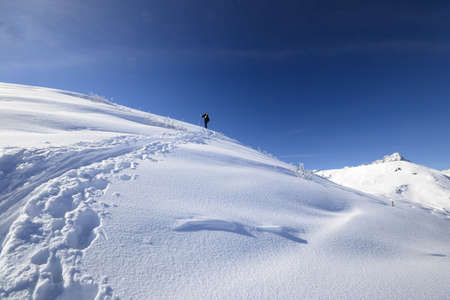Back country skiing in scenic high mountain landscape and superb view  photo