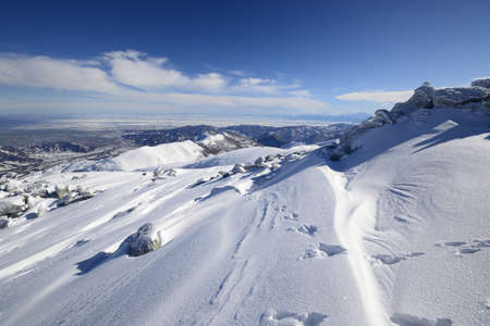 cuneo province: Wide angle view of the alpine arc in Piedmont, Italy, with windswept snowdrift in the foreground Stock Photo